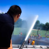 Fire Department Spraying Hose on Park Youth (jpg)