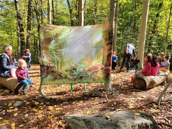Children in Nature Pod, convene at  the Woodlands Circle Site
